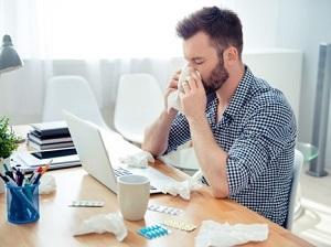 Office Working Blowing His Nose and Obviously Sick