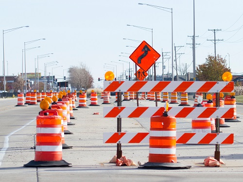 Work Zone with Traffic Drums, Barricades and Signs