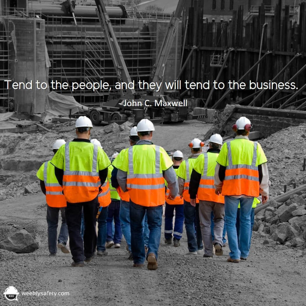 Group of construction workers walking towards their job site.