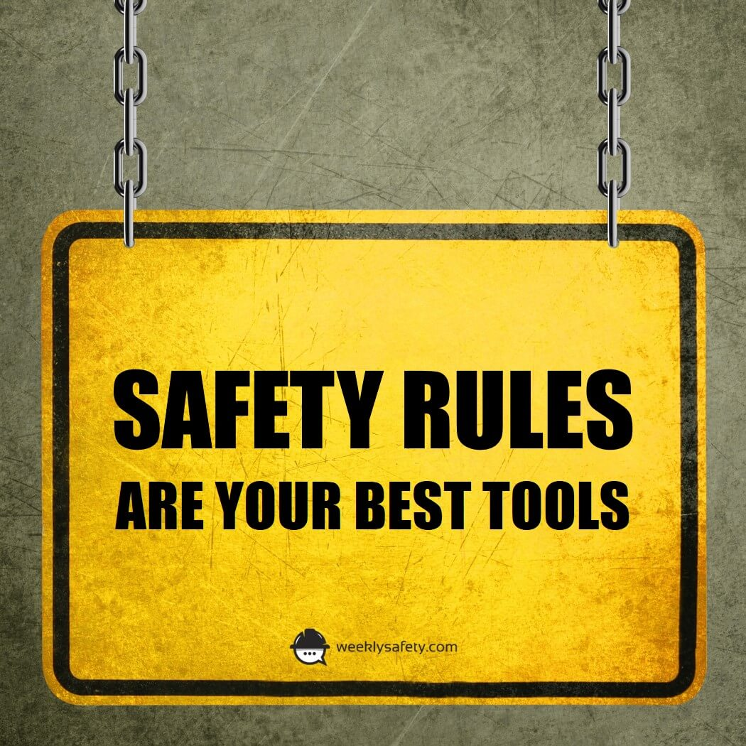 "Yellow warning sign with the words ""Safety rules are your best tools""."