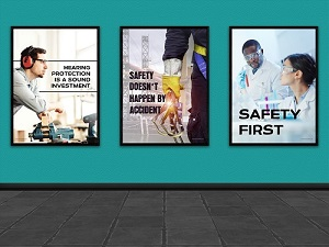 Three Framed Safety Posters Hanging on a Turquoise Wall