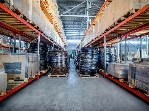 Two Large Spools of Cable Blocking an Aisle of a Warehouse