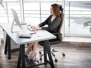 Woman Sitting at Work Desk with Good Posture