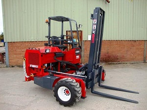 Moffett brand forklift, painted red, not in operation