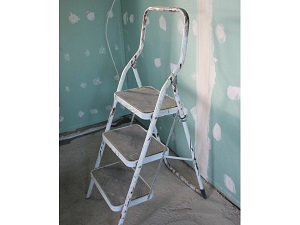 Step stool with three steps used for indoor painting project.