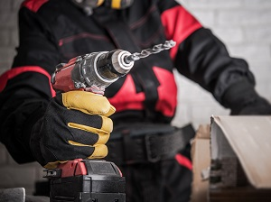 Worker Holding a Battery-Powered Drill