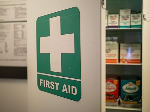 First Aid Kit on the Wall in a Workplace