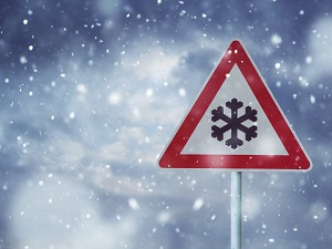 Winter Storm Warning Sign in Snow