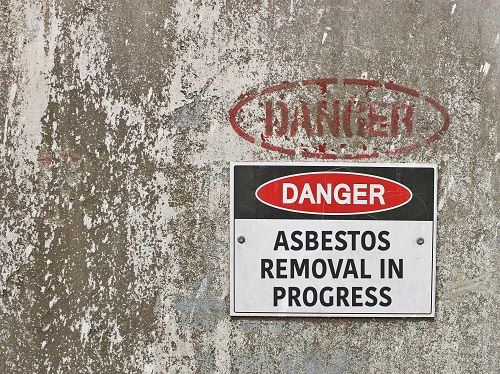 Danger sign that says Asbestos Removal in Progress
