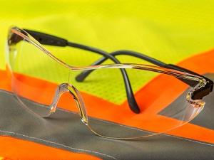 Safety glasses laying on a safety vest.
