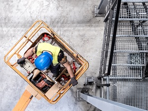 Overhead view of a construction worker on an aerial lift.
