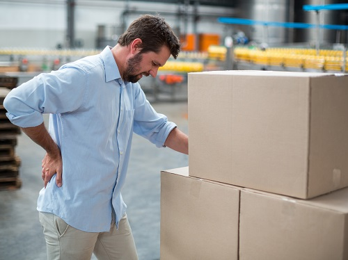 Warehouse worker that has back pain from lifting heavy boxes.