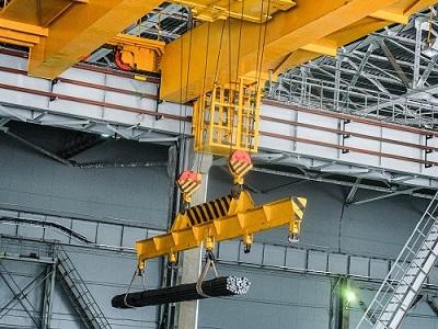 Overhead crane in an industrial environment.