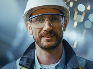Worker wearing safety glasses and a hard hat.