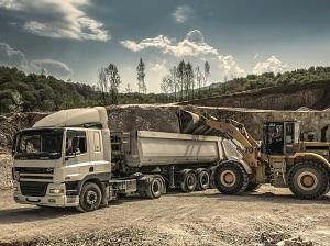 Excavator loading a dump truck.