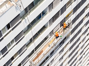 Aerial view of a suspended scaffold with two workers on it.