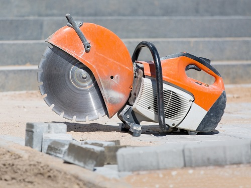 Large handheld power saw not currently in use with blade attached.