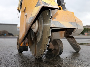 Close-up view of a walk-behind saw not in operation.