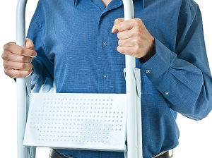 A person holding and carrying a step ladder.