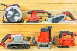 Assorted electrical tools on shelves.