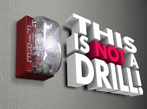 """Fire Alarm with Graphic Words that say, """"This is not a Drill!"""""""
