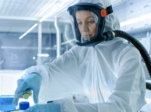 Lab worker wearing respiratory protection.
