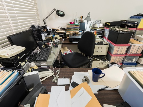 Very messy office desk.