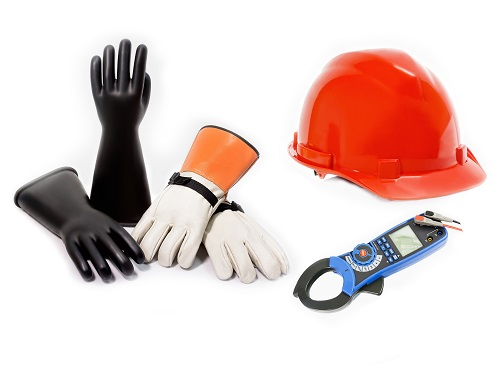 Electrical safety equipment including gloves and a hardhat.