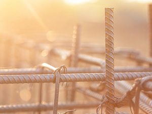 Close-up image of tied rebar on a construction site.