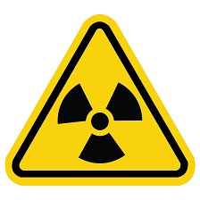 Radiation hazard sign in yellow and black that is shaped like a triangle.