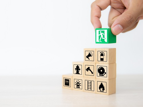 Building blocks with images of fire prevention icons.