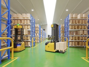 Automated Guided Vehicle performing work in a warehouse similar to a forklift.