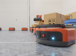 Automated Guided Vehicles transporting packages in a warehouse.