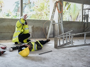A worker fell off a step ladder and another worker is calling for help.