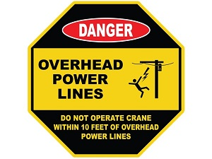 """An octagonal warning sign that is yellow and black that says, """"Danger, Overhead Power Lines, Do Not Operate Crane Within 10 Feet of Overhead Power Lines."""""""