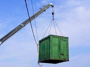 A crane lifting a heavy load near overhead power lines.