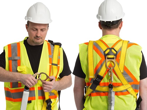 A worker wearing a hard hat and a safety vest demonstrating how to wear a personal fall arrest system shown from the front and the back.