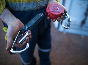 A worker demonstrating how a snap hook works.