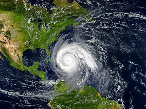 Aerial view of Earth showing a hurricane moving towards the United States.