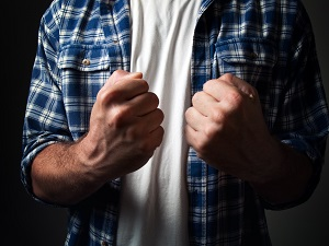A person with their fists raised indicating they are ready to fight.