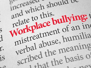A dictionary page showing the definition of Workplace Bullying.