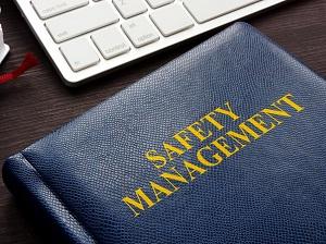 A folder on a work desk that says Safety Management.