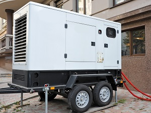 Larger portable generator on a trailer that is outside of an office building.