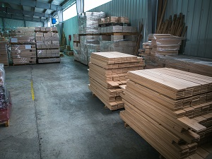 Warehouse with neatly stacked flooring planks.