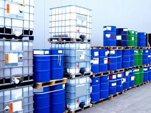 Hazardous materials in barrels stored outside.