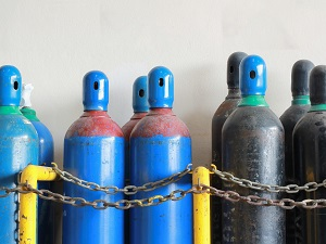 Compressed gas cylinders stored upright.