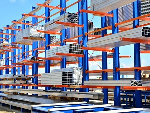 Outdoor racking with materials stacked neatly.