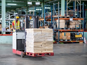Warehouse worker operating a forklift.