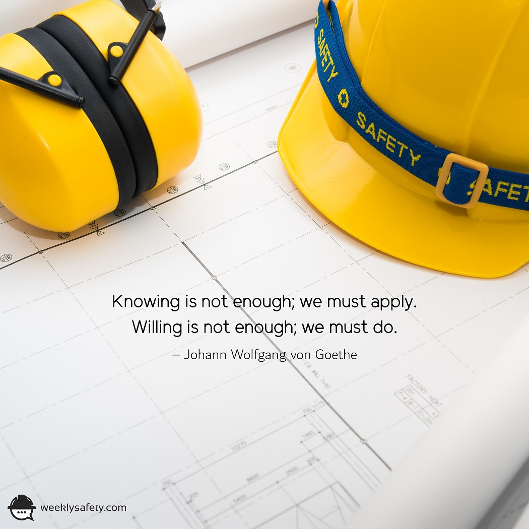 A yellow hardhat and yellow earmuffs on construction drawings.