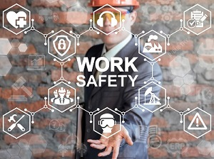 A worker wearing a hard hat with work safety icons superimposed onto his image as a representation of workplace safety.